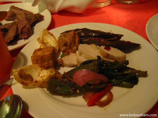 Clockwise from left - rojak, sambal eggplant, roasted chicken, chilli kangkong and spicy okra salad.